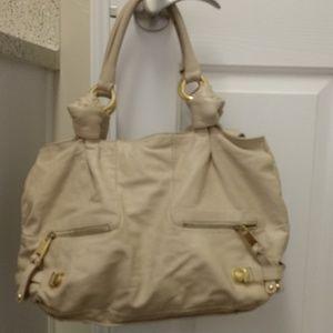 Cream colored leather purse.